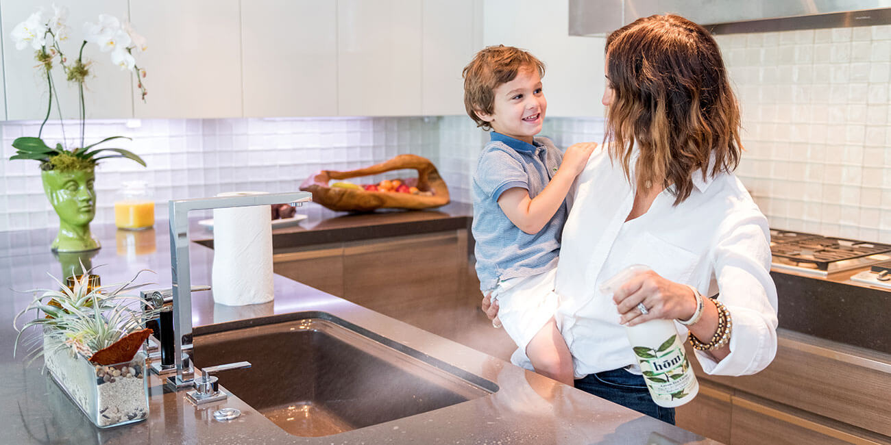 Mother cleaning kitchen with son